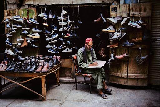 Mc Curry leggere venditore di scarpe